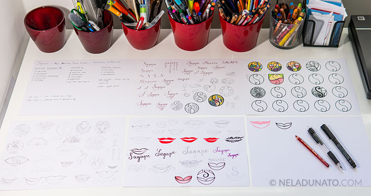 My work desk with logo sketches on paper