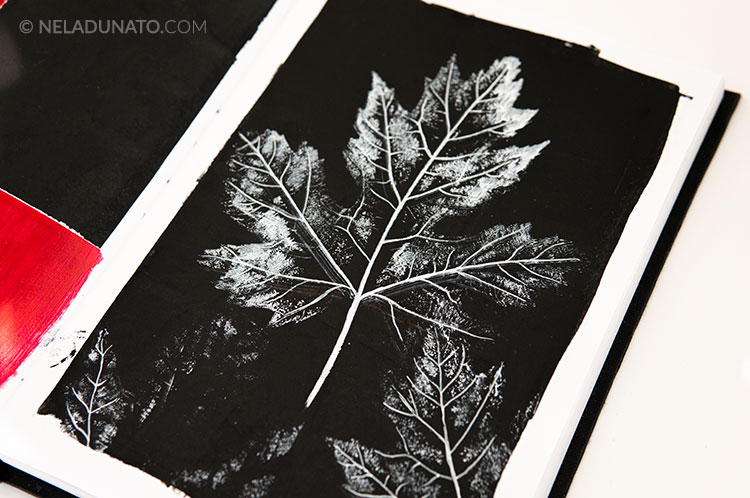 Nature journal sketchbook - printing with leaves on black gesso