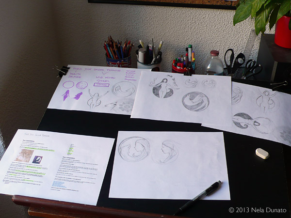 My desk with sketches for a logo